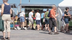 People Shopping At A Local Farmers Market For Fresh Produce Stock Footage
