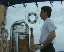 Man steering boat Stock Footage