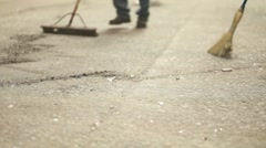 Abstract shot of brooms sweeping dust on a hard floor. Stock Footage