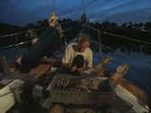 Man barbecuing food on boat deck Stock Footage