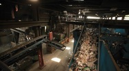 Stock Video Footage of Recycled materials travel on a conveyor belt at a recycling center.