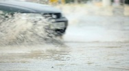Stock Video Footage of car splashes on flooded street