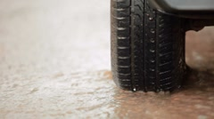 Car tire in a stream of of rainwater Stock Footage
