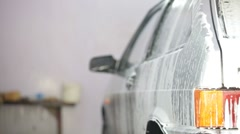Car in soap foam Stock Footage