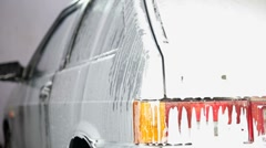 Car in suds Stock Footage