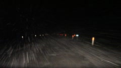 Driving in the snow at night Stock Footage