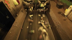 Recycling materials move along a conveyor belt in a factory. Stock Footage