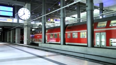 Europe, Germany, Berlin, modern train station - train pulling out of the station Stock Footage