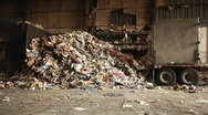 Stock Video Footage of Skip loader shovels recycling at a factory.
