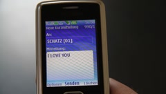 """Send SMS: """"I LOVE YOU"""" Stock Footage"""