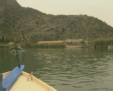 View of river from front of moving boat as it approaches cliff tombs Stock Footage