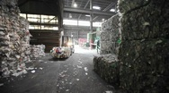 Stock Video Footage of Aluminum cans are recycled at a center.