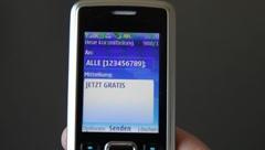 "Send SMS: ""JETZT GRATIS"" Stock Footage"