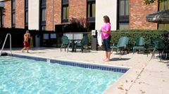 Mother drying off child who just got out of the pool. Stock Footage