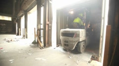 Skip loaders move aluminum blocks at a recycling center. Stock Footage