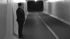 Mobster standing in tunnel waiting Stock Footage