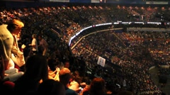 Crowd in an arena awaiting an event. - stock footage