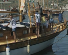 People sitting on moored gulet Stock Footage