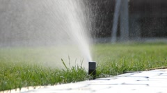 Watering of grass. slow motion. Stock Footage