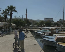 Pan from harbourside to moored boats Stock Footage