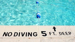 No diving sign - 5 feet deep next to pool Stock Footage