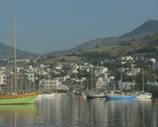 Zoom out from harbourside to moorings - stock footage