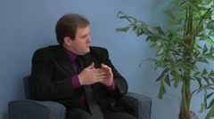 Anxious man in waiting room part 2 Stock Footage