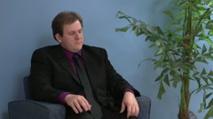 Anxious man in waiting room part 1 Stock Footage