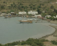 Zoom out from moored gulet in bay Stock Footage