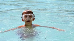 Young boy with mask in swimming pool. Stock Footage