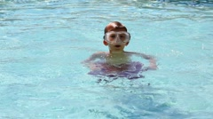Young boy wearing swiiming mask in a pool. Stock Footage
