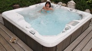 Stock Video Footage of Woman relaxing in a Whirlpool and laughs