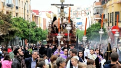 Stock Video Footage of Costaleros bearing a Trono in a procession, Andalucia, Spain