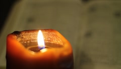 Bible and Candle - stock footage