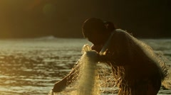 Classic shot of Polynesian fisherman throwing net. Stock Footage