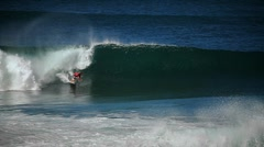 Surfer riding waves. Stock Footage