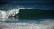 Stock Video Footage of Surfer riding waves.