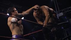Pro wrestling match - Hard hitting strikes in corner HD - stock footage