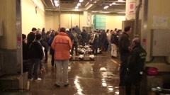 Handheld view Walking Into Auction At Tsukiji Fish Market in Tokyo Japan - stock footage