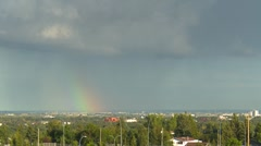 Rainbow and storm clouds Stock Footage