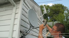 Satellite dish adjustment - stock footage