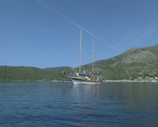 View of moored gulet from a circling speedboat Stock Footage
