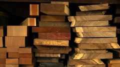 Planks of wood and lumber are stacked vertically. Stock Footage