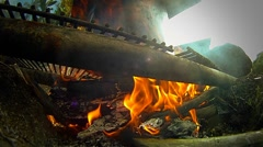 A fire burns under a kettle in a campground. Stock Footage