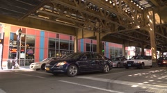 Chicago street scene, traffic under the elevated railway in Chicago. Stock Footage