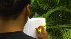 OTS CU Hawaiian male reading book and highlighting, Hawaii Stock Footage