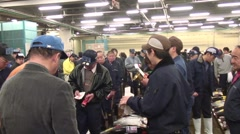 Tuna Auctioneer At Tsukiji Fish Market with audio Stock Footage