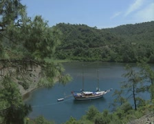 Distant view of gulet in bay Stock Footage