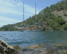 Ground level view of moored gulet and small boat Stock Footage