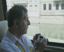 Close up of man taking photos of city Stock Footage